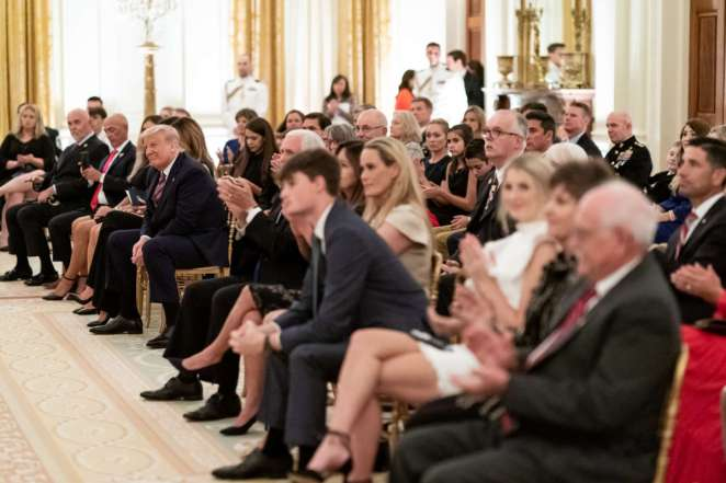 President Donald J. Trump listens as songs are sung at a remembrance candle lighting during a reception to honor Gold Star Families Sunday, September 27, 2020, in the East Room of the White House.