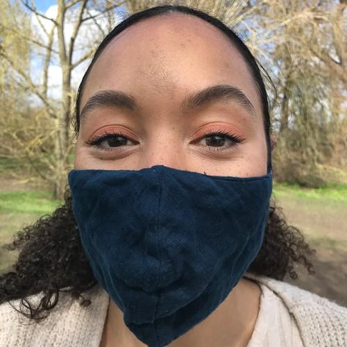 Photo of Senior Writer, MetroUK - Natalie Morris wearing a COVID mask