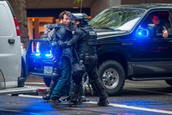 White Man Pulls Gun On Crowd Of Portland Protesters As He Was Surrounded (Video)