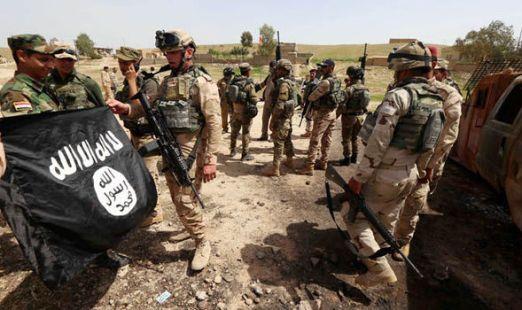iraqi-troops-isis-flag-713115