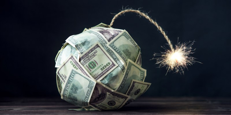 US is a Banana Republic. Bomb of money hundred dollar bills with a burning wick.