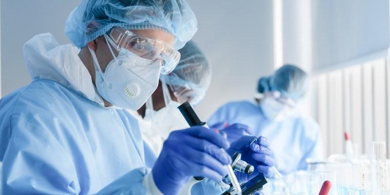 Scientists in a biochemical lab