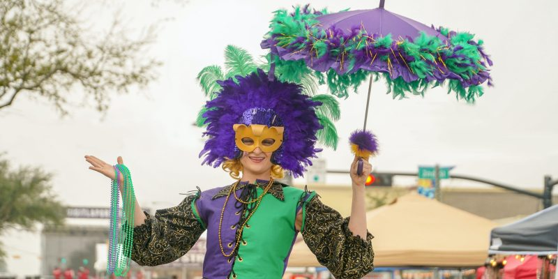 woman in purple and white dress holding umbrella
