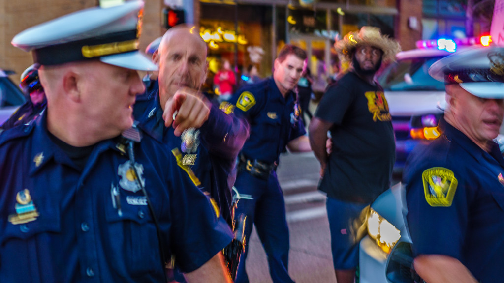 A Cincinnati police officer singles me out of the crowd for photographing illegal arrests.
