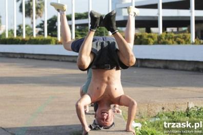Morning gymnastics. Grzesiek in the background, Cambodia