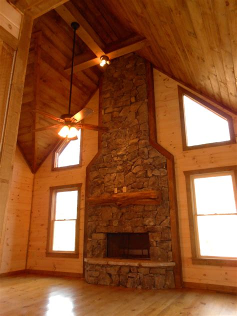 heavy stack fieldstone cedar log fireplace mantel