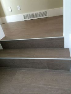 wood floor tile on stairs with metal end cap tile stairs tiled staircase laminate stairs - Floor Tiles Stairs