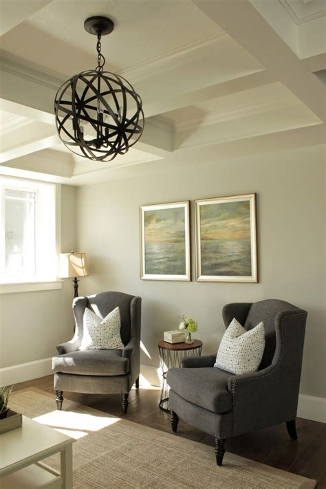 living room sitting area wing chairs orb chandelier
