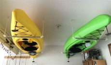 easy ways to hang kayak in garage easy way to hang kayaks all you need is rope pvc pipe plumbers glue and some hooks for the