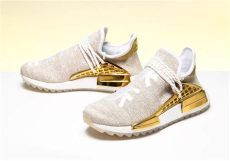 adidas pharrell nmd hu china pack happy gold price pharrell x adidas originals hu nmd trail in gold hypebae