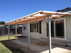 exterior simple wood awning with 4 columns as front porch in backyard landscaping ideas - Simple Awning Plans