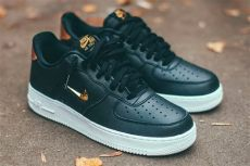 air force 1 jewel black gold nike s air 1 07 lv8 gets a metallic gold makeover