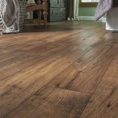 pergo vinyl flooring lowes shop pergo max premier 7 48 in w x 4 52 ft l chestnut embossed laminate wo home
