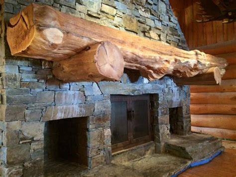 massive stone fireplace wood mantel