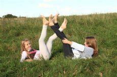 foosites kids lying in grass stock image image of 45761287