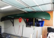 hang kayak in garage how to hang a 17 ft canoe in a 19 ft garage the canoe is just low enough where the garage