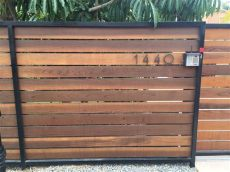 metal gate frame for horizontal wood fence horizontal redwood fence 5 5 quot pickets stained metal frame yelp