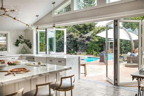 light gray kitchen cabinets calcutta gold marble backsplash