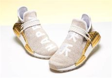 adidas pharrell nmd hu china pack happy gold price pharrell adidas nmd hu china gold happy f99762 sneakernews