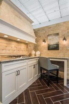 faux wood tile in kitchen warm woodsy hues of mahogany for your kitchen floor