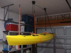 how to hang kayak from garage ceiling kayak on ceiling diy canoe outrigger ceiling and kayak storage
