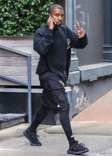 kanye west wearing yeezy 350 v2 wearing air jordans sneaker bar detroit