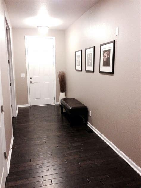 front entry dark distressed hardwood floors sherwin williams