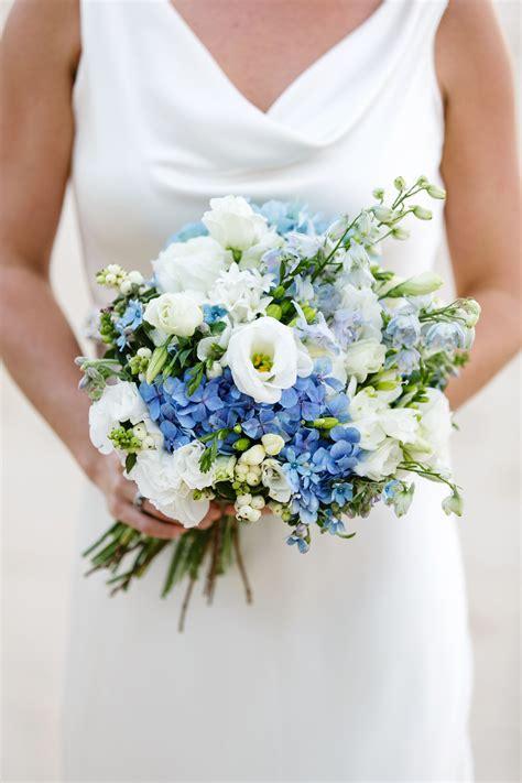 country style bouquet consiting blue delphinium hydrangea white