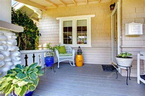 covered entrance porch plants chair stock photo iriana88w