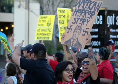 """Fuck Donald Trump,"" offensive to some, pretty much summed up the sentiments of several of opponents of presidential candidate Donald Trump at a raucous rally and march Tuesday evening outside the Albuquerque Convention Center."