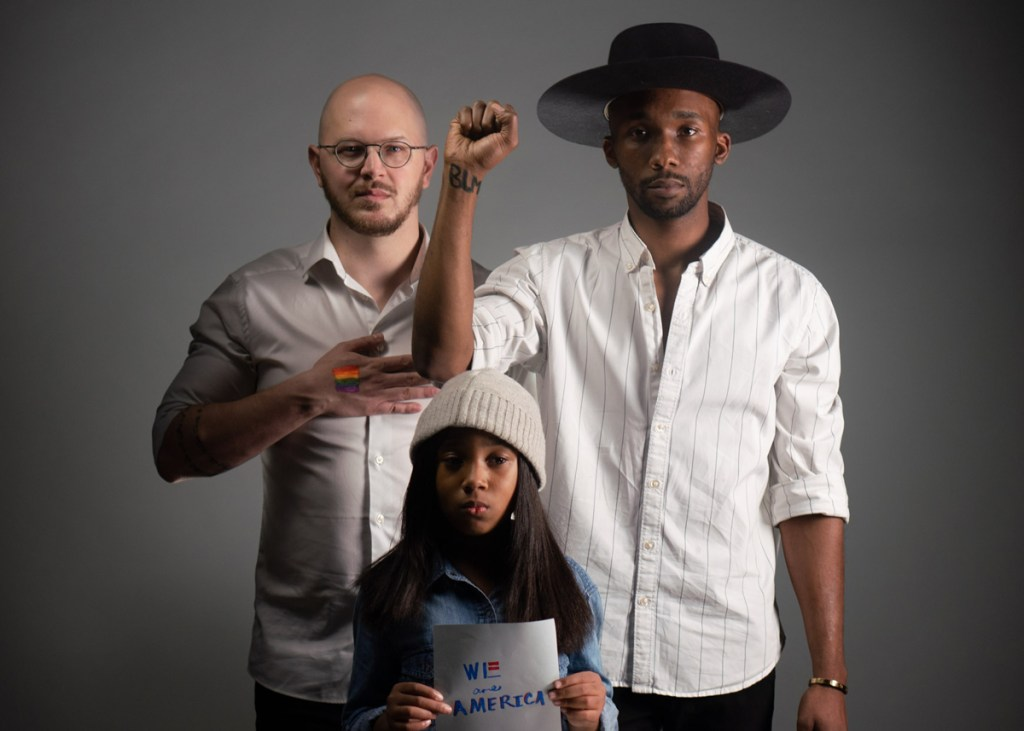 Timothy Shepard, Drek Shepard, and Tylan Shepard pose for their We Are America Challenge.
