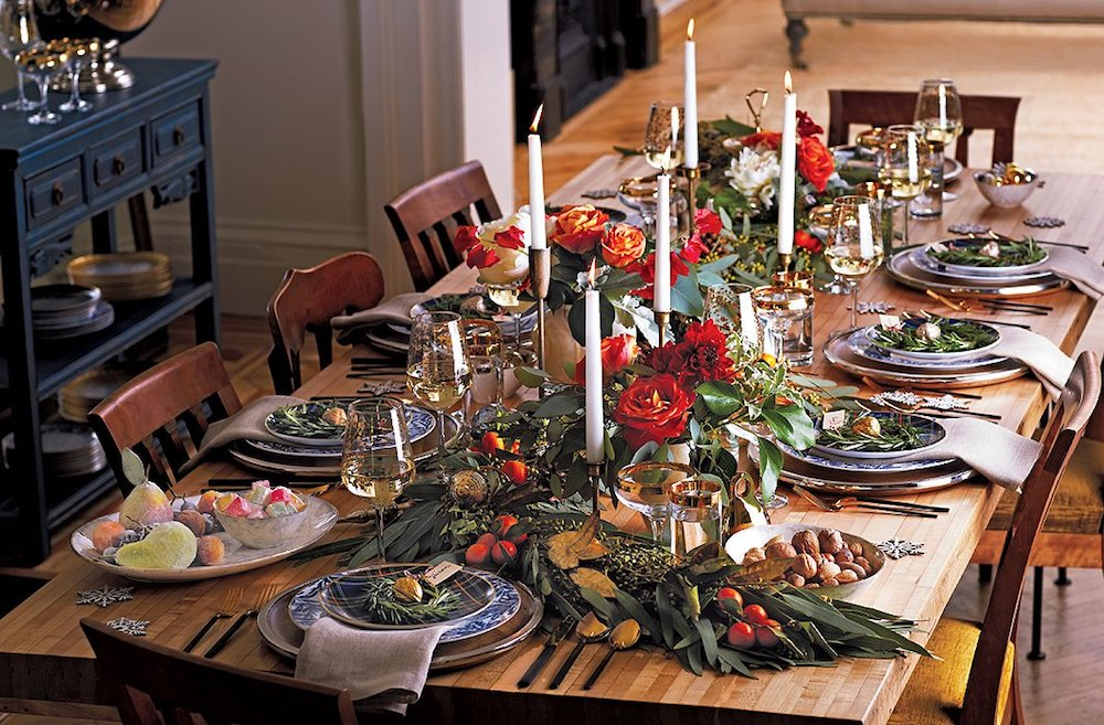 One of great Christmas table settings is decorating with greenery