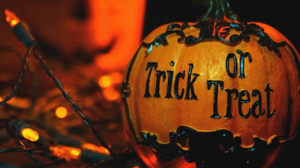 Do you know why we trick or treat on Halloween Day?