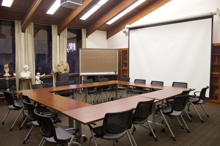 Empty classroom with several black chairs