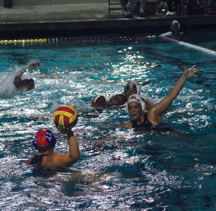 A waterpolo player gets ready to pass the ball