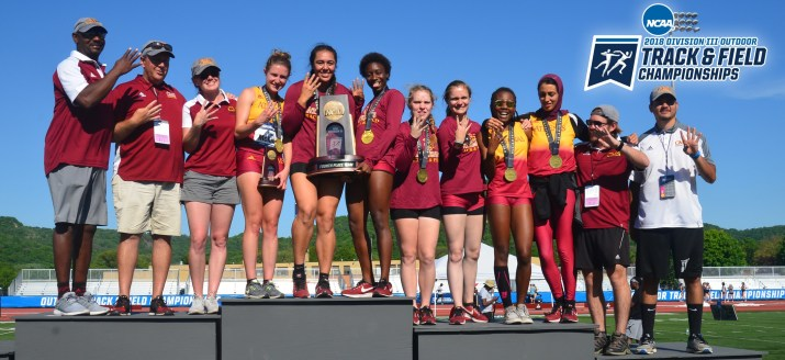 The CMS women's track team pose with their trophies and medals.