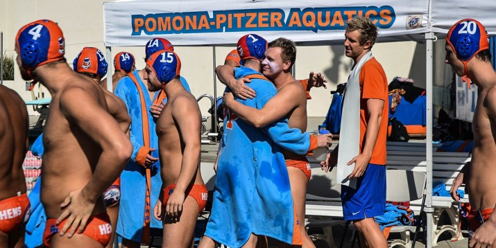 Several male waterpolo players hug