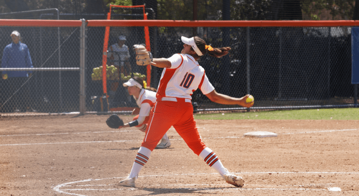 """Liz Rodarte PZ '19 throws a pitch. She is wearing a orange and white uniform with the number """"10."""""""