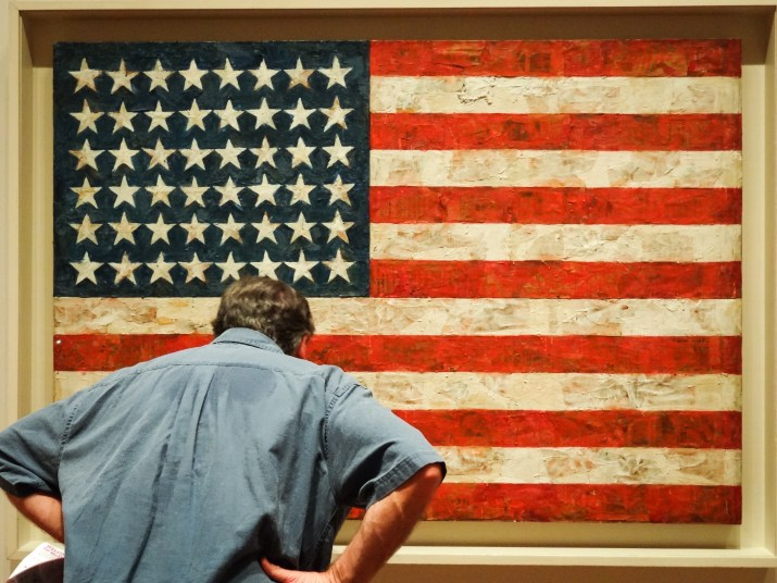 A man staring at an American flag