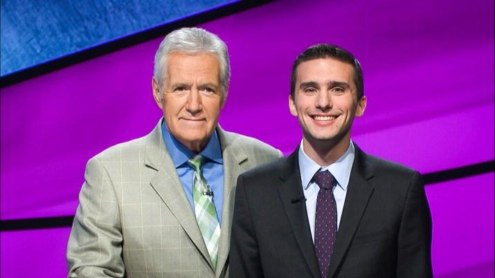 A Claremont McKenna College student smiles with Jeopardy host Alex Trebek