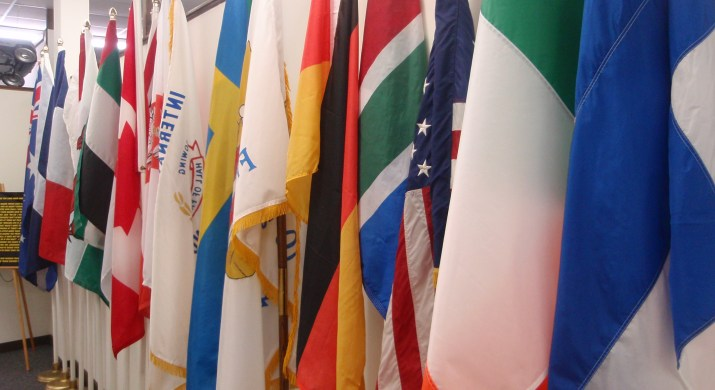 many different countries flags in a room