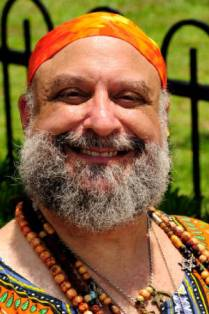 A picture of a spiritual man, Jnanda, in an orange cap.