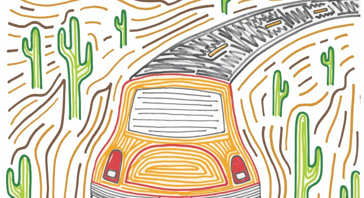 An orange car drives down a desert road lined by cacti.