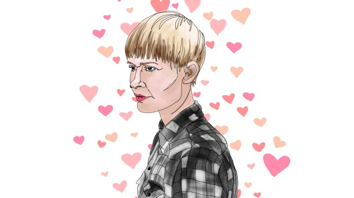 Norwegian singer-songwriter Jenny Hval wearing a gray flannel while surrounded by pink hearts.