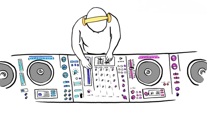 A DJ wearing yellow headphones adjusts various multicolored dials on a soundboard.