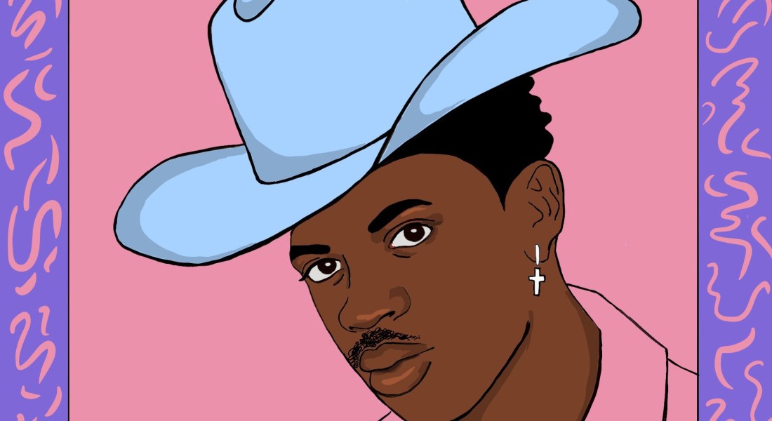 Lil Nas X the American singer wears a bright blue cowboy hat and a cross earring.