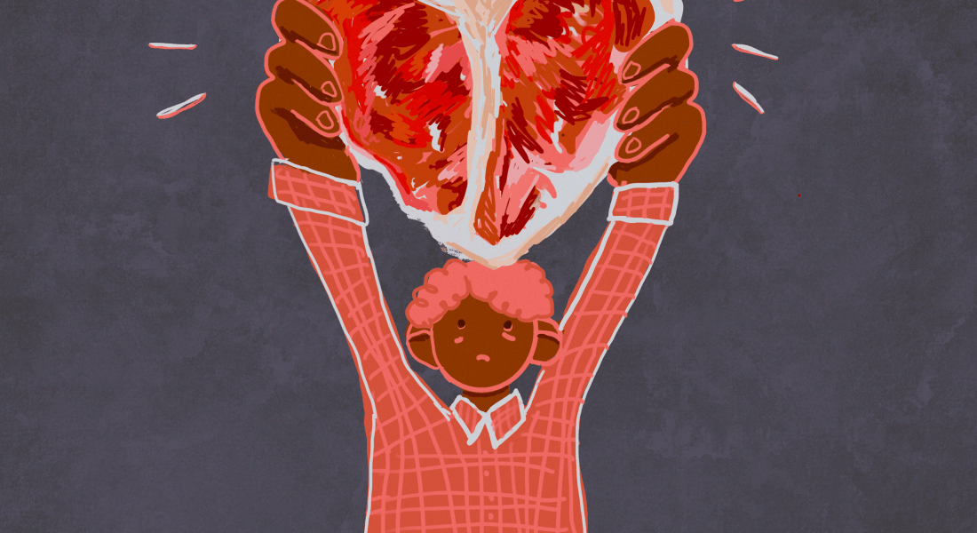 A person holds up a steak shaped like meat.