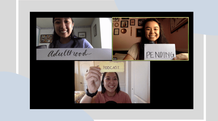 """A screenshot of a Zoom group video call with three women. Each person holds a piece of paper up to the camera to spell out """"Adulthood Pending Podcast."""""""