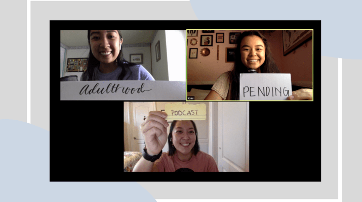 "A screenshot of a Zoom group video call with three women. Each person holds a piece of paper up to the camera to spell out ""Adulthood Pending Podcast."""