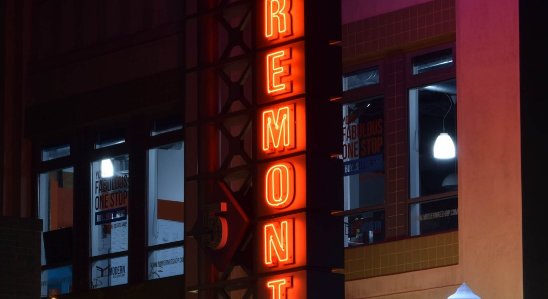 """A movie theater has a """"Laemmle's Claremont"""" sign."""